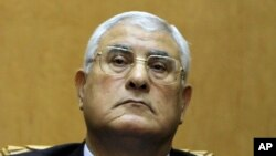 Egypt's chief justice Adly Mansour listens to a speech during his swearing in as interim president Thursday, July 4, 2013.