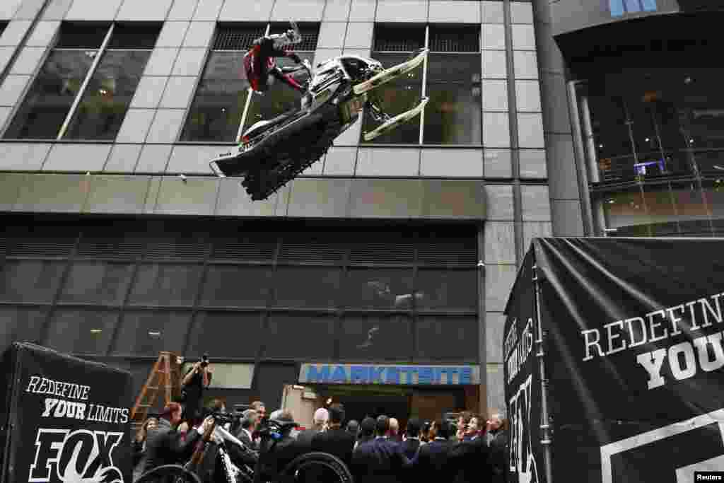 Snowmobile racer Levi LaVallee jumps his snowmobile as executives from Fox Factory Holding Corp. ring the opening bell for the Nasdaq Market to celebrate the company's IPO in New York.