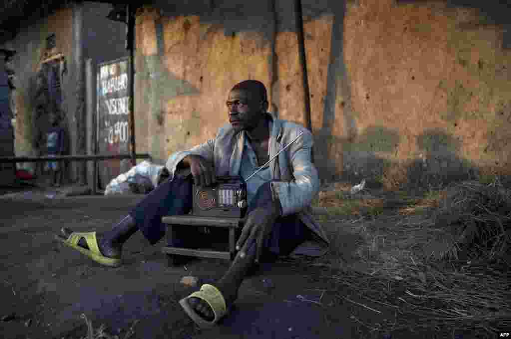 A man listens to the news on a shortwave radio in Bujumbura, Burundi, July 22, 2015.