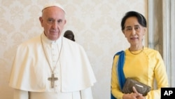 FILE - State Counsellor and Union Minister for Foreign Affairs of the Republic of the Union of Myanmar Aung San Suu Kyi, right, poses with Pope Francis on the occasion of their private audience, at the Vatican, May 4, 2017.