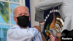 U.S. President Joe Biden receives his coronavirus disease (COVID-19) booster vaccination in the Eisenhower Executive Office Building's South Court Auditorium at the White House on Sept. 27, 2021.