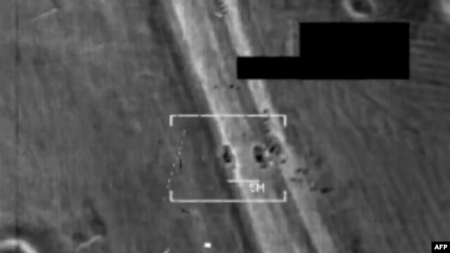 Image-grab shows F/A-18 Hornet fighter jet strike on what US army officals call an Islamic State target at undisclosed location in northern Iraq, August 8, 2014.