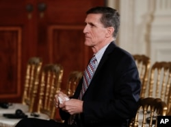 FILE - National Security Adviser Michael Flynn sits before the start of the news conference of President Donald Trump and Japanese Prime Minister Shinzo Abe in the East Room of the White House, Feb. 10, 2017. The House intelligence committee is issuing su