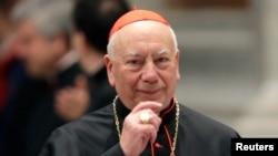 FILE - Italian Cardinal Francesco Coccopalmerio arrives to attend a prayer at Saint Peter's Basilica in the Vatican.