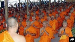 In this 2005 file photo, some 480 hill tribe ethnic minority men temporarily entered the Buddhist monkhood for five days at a ceremony in Chiang Mai, Thailand, after the Thai government granted them citizenship, and they became monks to celebrate