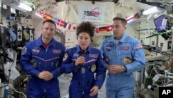 In this image from video made available by NASA, U.S. astronaut Jessica Meir speaks, accompanied by Andrew Morgan and Chris Cassidy, during a news conference held by the American members of the International Space Station on Friday, April 10, 2020…