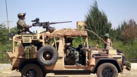 French special forces drive through the city of Gao, Northern Mali, Jan. 30, 2013.