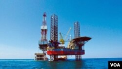 Ladang minyak di Teluk Bohai yang dioperasikan oleh ConocoHillips dan CNOOC, Perusahaan Minyak Lepas Pantai Nasional Tiongkok.