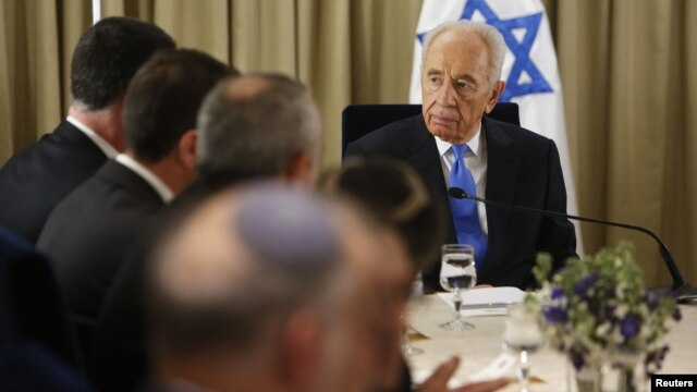 srael's President Shimon Peres (R) sits next to representatives of Israeli Prime Minister Benjamin Netanyahu's Likud-Beitenu party in Jerusalem Jan. 30, 2013, after receiving the official results of the general elections held Jan. 22.