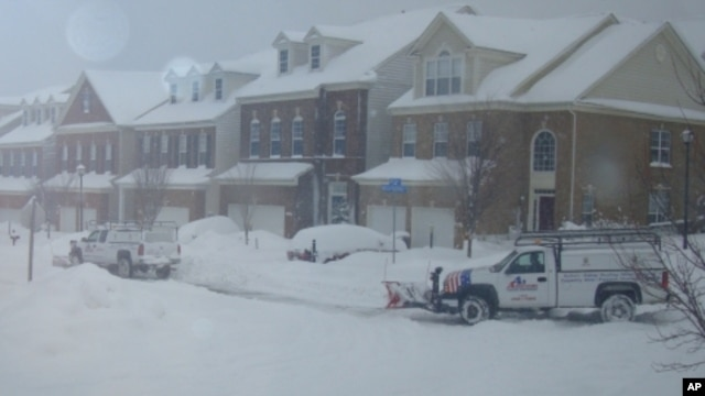 Snow removal crews plowing streets in Washington, DC suburb of Lorton, VA, 8 Feb. 2010