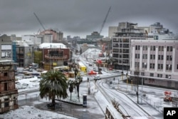 FILE - A layer of snow covers roads in Christchurch, New Zealand, Friday, June 21, 2013.