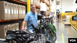 Don DiCostanzo, CEO and co-founder of Pedego, moved his bike manufacturing from China to Vietnam because of trade tariffs imposed by the U.S. on goods from China, including electric bikes. (VOA/ R. Kim)