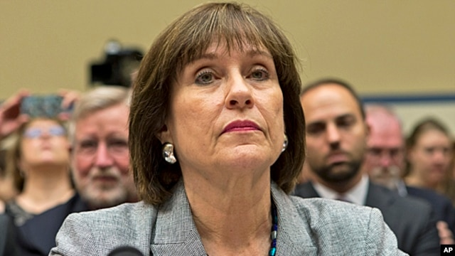 Lois Lerner, head of the IRS unit that decides whether to grant tax-exempt status to groups, listens on Capitol Hill in Washington,  May 22, 2013.
