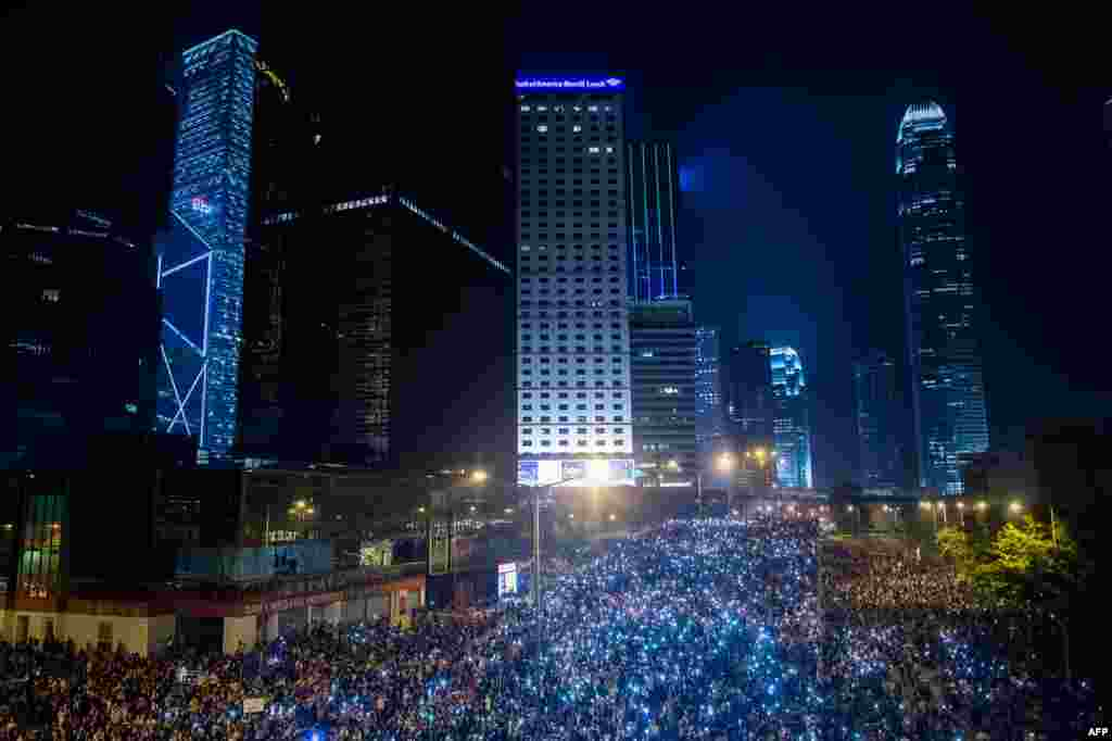 Pro-democracy demonstrators come together for the third night in Hong Kong to demand democratic elections after Beijing said it would allow elections for Hong Kong's's next leader in 2017 but would have to approve the candidates.