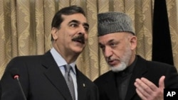 Pakistan's Prime Minister Yousuf Raza Gilani, left, speaks with Afghanistan's President Hamid Karzai during a news conference in Kabul, Afghanistan, April 16, 2011