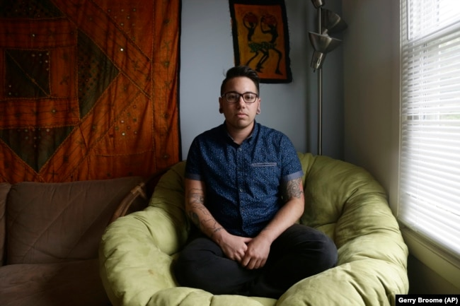 In this photo taken Thursday, May 5, 2016 Joaquin Carcaño is shown at his home in Carrboro, N.C. Carcaño, a 27-year-old transgender man, works for the University of North Carolina at Chapel Hill.