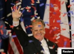 Democratic Alabama U.S. Senate candidate Doug Jones acknowledges supporters at the election night party in Birmingham, Alabama, Dec. 12, 2017.