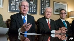 From left, Senate Majority Leader Mitch McConnell, R-Ky., Senate Finance Committee Chairman Orrin Hatch, R-Utah, and Treasury Secretary Steven Mnuchin speak to reporters in Washington, Nov. 9, 2017.