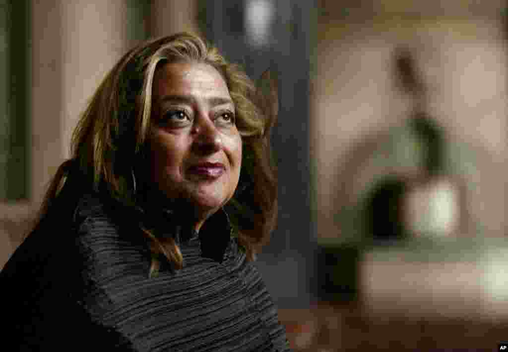 FILE- Iraqi-British architect Zaha Hadid poses in West Hollywood, California, March 21, 2004. Hadid, whose modernist, futuristic designs include the swooping aquatic center for the 2012 London Olympics, died at age of 65, Thursday, March 31, 2016.