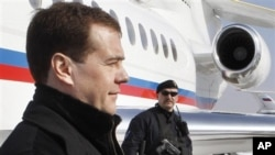 Russian President Dmitry Medvedev, left, February. 22, 2011