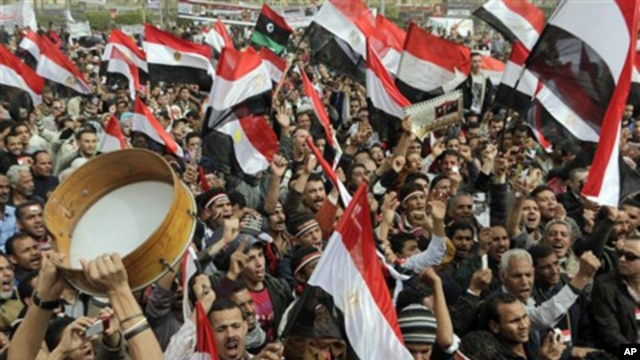 Thousands of Egyptians shout slogans as they gather at Tahrir Square, the focal point of the Egyptian uprising, in Cairo, Egypt, February 25, 2011