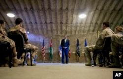 U.S. Defense Secretary Ash Carter talks to U.S. and Jordanian forces at a Jordanian air base, July 21, 2015.