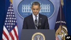 """12月14日晚﹐奧巴馬總統在華盛頓向公眾發表講話,稱這些無辜的死亡讓""""我們的心都碎了"""""""