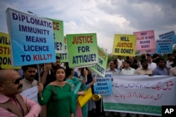 FILE - Pakistani protesters stage a rally demanding a trial for the American diplomat involved in a vehicle crash that killed one person, in Islamabad, Pakistan, April 10, 2018.