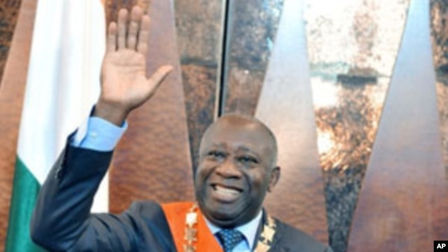 Laurent Gbagbo waves after being formally sworn-in as Ivorian president during a ceremony in Abidjan, 04 Dec 2010