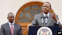 Kenya's President Uhuru Kenyatta, right, accompanied by Deputy President William Ruto, left, speaks to the media about the upcoming visit of U.S. President Barack Obama, among other issues, at State House in Nairobi, Kenya, July 21, 2015.