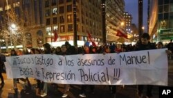 "Students hold a banner, which reads: ""Trial and punishment to the murderers of Manuel, enough of police repression!"", during a rally in downtown Santiago, August 26, 2011"