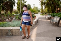 Arizona State University political science major Betzabel Ayala poses for a photo on campus Tuesday, Sept. 8, 2020, in Tempe, Ariz. Because of the coronavirus, Ayala is one of hundreds of thousands of off-campus U.S. college students who are being counted
