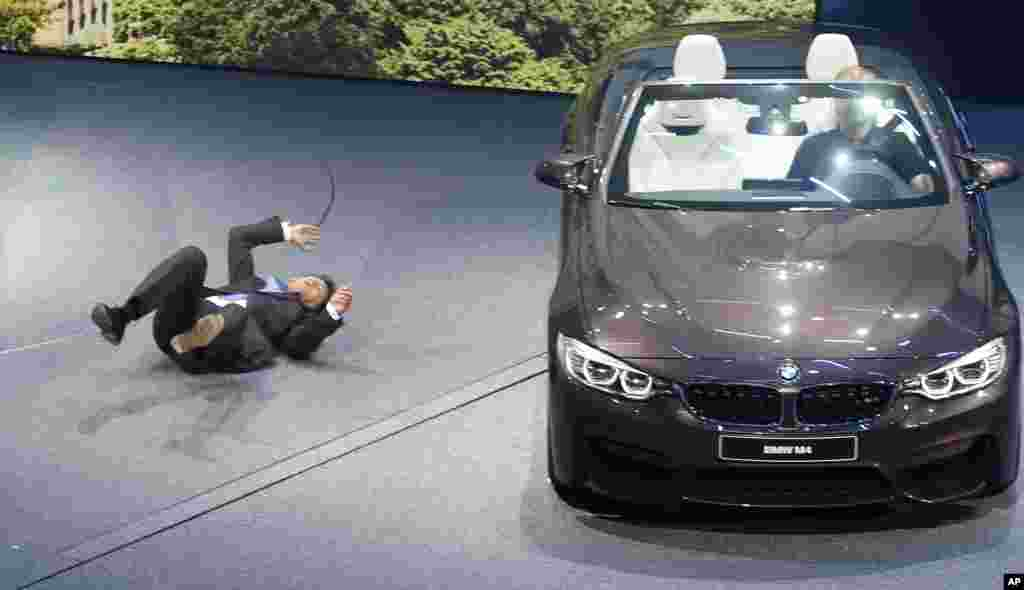 BMW CEO Harald Krueger collapses during the presentation on the first press day of the Frankfurt Auto Show IAA in Germany.
