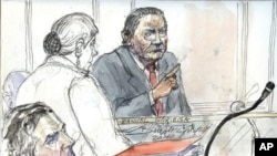 A court sketch made at the Paris courthouse shows former Panamanian dictator Manuel Noriega (R) and one of Noriega's lawyer Yves Leberquier (L), during his trial, 28 Jun 2010