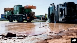 Tons of liquid milk chocolate are spilled and block six lanes on a highway after a truck transporting it overturned near Slupca, in western Poland, on Wednesday, May 9, 2018. (AP Photo)