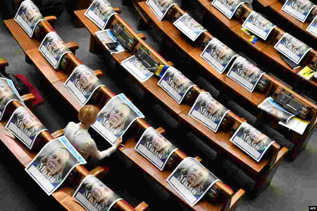 "A deputy reads a special edition of the newspaper ""Dzerkalo Tyzhnia"" dedicated to mothers of Ukrainian servicemen who died in the battle with Russia-backed separatists, before the solemn opening and first sitting of the new parliament in Kyiv."