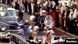 FILE - President John F. Kennedy and Mrs. John F. Kennedy, and Texas Governor John Connally ride through Dallas moments before Kennedy was assassinated, Nov. 22, 1963.
