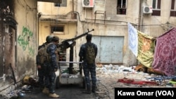 FILE - Iraqi forces are seen in Bab Jadid neighborhood, Mosul, Iraq, April 3, 2017. Islamic State militants reportedy shelled Iraqi forces with chemical weapons agents in the Urouba and Bab Jadid districts on April 15.