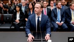 Facebook CEO Mark Zuckerberg arrives to testify before a House Energy and Commerce hearing on Capitol Hill in Washington, Wednesday, April 11, 2018. (AP Photo/Andrew Harnik)