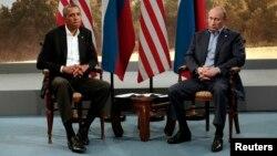 Барак Обама, Владимир Путин на встрече в кулуарах саммита G8 в Северной Ирландии. 17 июня 2013 г.