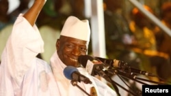 FILE - Gambia's then-President Yahya Jammeh smiles during a rally in Banjul, Gambia, Nov. 29, 2016.