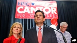 House Majority Leader Eric Cantor, R-Va., delivers his concession speech as his wife, Diana, listens in Richmond, Va., June 10, 2014. Cantor lost in the GOP primary tp tea party candidate Dave Brat.