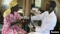 A woman is given a free HIV/AIDS test in Lira, northern Uganda, September 9, 2007.