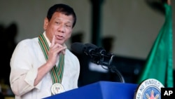 FILE - Philippine President Rodrigo Duterte gestures while addressing army troops during the 120th anniversary celebration of the Philippine Army, April 4, 2017 at Fort Bonifacio.