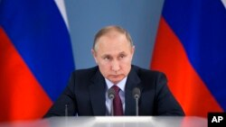 Russian President Vladimir Putin attends a meeting during his visit to Samara, Russia, March 7, 2018. Putin had more words of praise for U.S. President Donald Trump in a documentary released March 7 but expressed disappointment with the U.S. political sys