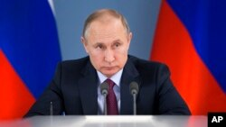 Russian President Vladimir Putin attends a meeting during his visit to Samara, Russia, March 7, 2018. Putin had more words of praise for U.S. President Donald Trump in a documentary released March 7 but expressed disappointment with the U.S. political system.
