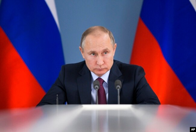 Russian President Vladimir Putin attends a meeting during his visit to Samara, Russia, March 7, 2018. Putin had more words of praise for U.S. President Donald Trump in a documentary released March 7.