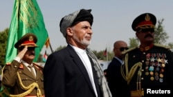 FILE - Afghan President Ashraf Ghani attends Afghan Independence Day celebrations in Kabul, Afghanistan, Aug. 19, 2017.