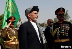 FILE - Afghan President Ashraf Ghani attends Afghan Independence Day celebrations in Kabul, Afghanistan, Aug. 19, 2017.