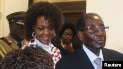 FILE - President Robert Mugabe and his wife Grace arrive to chair ZANU-PF's Politburo meeting at the party headquarters in Harare, Feb. 15, 2017.